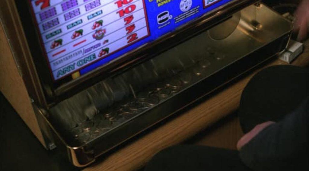 Vassoio dei gettoni di una slot machine vecchio stile